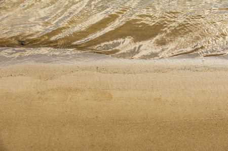granular: Texture, background. the sand on the beach. loose granular substance, pale yellowish brown, resulting from the erosion of siliceous and other rocks and forming a major constituent of beaches, Stock Photo