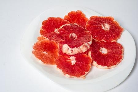 pulp: Grapefruit, a large, round, yellow citrus fruit with an acid, juicy pulp.
