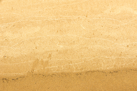 yellowish: Texture, background. the sand on the beach. loose granular substance, pale yellowish brown, resulting from the erosion of siliceous and other rocks and forming a major constituent of beaches, Stock Photo