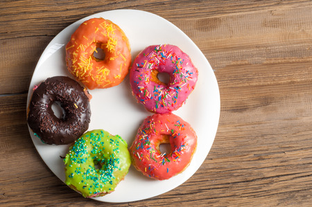 patty cake: donuts. Round fried in fat patty. a small fried cake of sweetened dough, typically in the shape of a ball or ring. sinker, fritter, doughnut, dough-boy