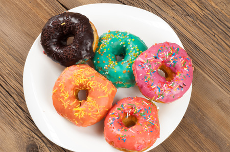 donuts. Round fried in fat patty. a small fried cake of sweetened dough, typically in the shape of a ball or ring. sinker, fritter, doughnut, dough-boy