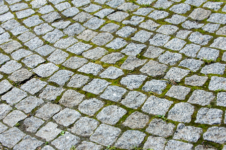 cobblestones: Texture, background. Background. Wild stone bridge lined with cobblestones Stock Photo