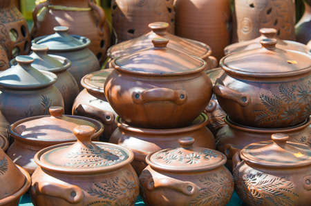 broadly: Texture, background. Pottery. pots, dishes, and other articles made of earthenware or baked clay. Pottery can be broadly divided into earthenware, porcelain, and stoneware. Stock Photo