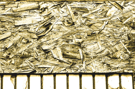 Vintage processing. Texture, background. Fiberboard. stiff board made of compressed and treated wood pulp. old.