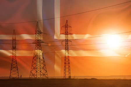 High-voltage power transmission line. Energy pillars. At sunset, dawn. high-tension. Flag of Iceland