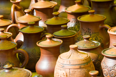 pottery. pots, dishes, and other articles made of earthenware or baked clay. Pottery can be broadly divided into earthenware, porcelain, and stoneware.