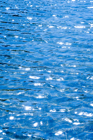 counter light: Texture background. The water in the pool is photographed in counter light. The glare from the sun on the waves