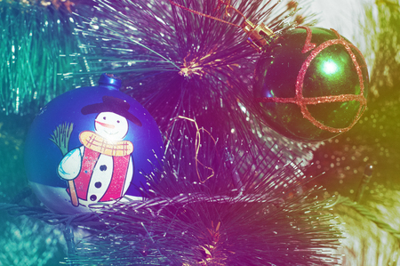 Vintage processing. Texture, background. Christmas tree with Christmas toys, colorful balloons