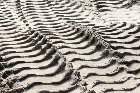 tread: texture, background. Footprints in the land of the tire tread Stock Photo