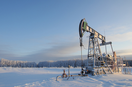 combustible: Winter landscape. Rocking oil. Oil pump. Mineral oily liquid combustible material, upotr. as fuel and as a raw material for various products