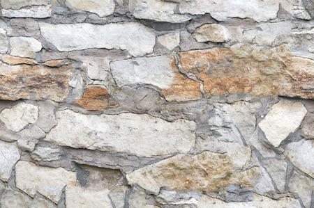 stone background: Seamless texture, background, stone lined with granite walls. sandstone. stone background wall.  Facing Stone