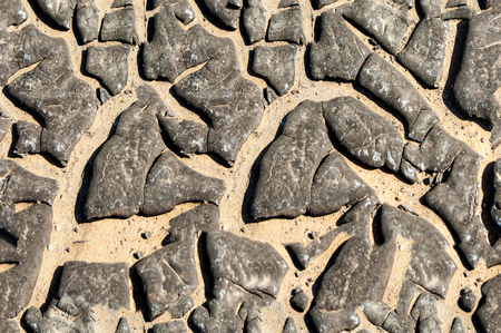 crannied: Texture, background, seamless pattern. This is useful for designers. Bitumen resin crack from the heat of the solar wind. Solid or viscous organic compound; substance used in road construction