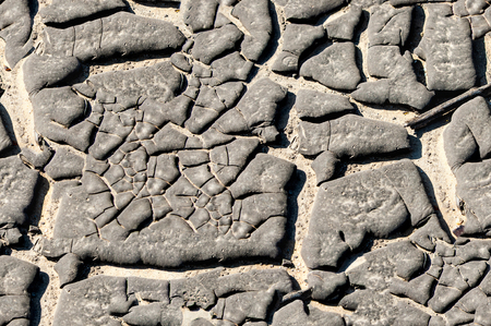 cracky: Texture, background, seamless pattern. This is useful for designers. Bitumen resin crack from the heat of the solar wind. Solid or viscous organic compound; substance used in road construction