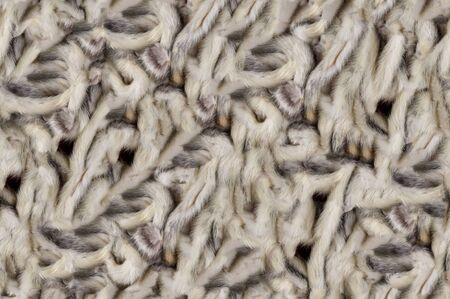 animal fur: Texture, background, seamless pattern. This is useful for designers. Mink fur animal. Fur predatory small animal of the family. martens brown with white shiny hair.