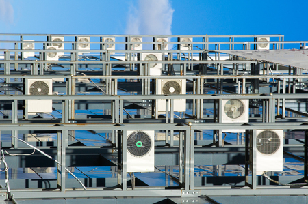 exhaust system: texture, background, pattern. Air conditioning. Apparatus for cooling air in a room. Stock Photo