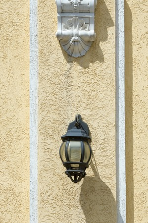 wall lamp: Texture, pattern, background. plaster on the wall lamp on a wall. a soft mixture of lime with sand or cement and water for spreading on walls, ceilings, or other structures Stock Photo