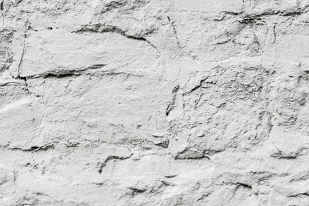 Texture, background. Background. Wild stone covered with white paint. Wall made of stone