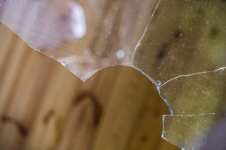 dismantle: Glass, window broken. a hard, brittle substance, typically transparent or translucent, made by fusing sand with soda, lime, and sometimes other ingredients and cooling rapidly. Stock Photo