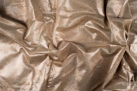 Texture, background. Crafted product from animal skins. the skin of the animal with shiny deposited structure. Decorative skins.
