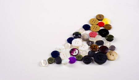 sewing buttons collection. Various sewing buttons with a thread. isolated.  collection of various sewing button on white background.