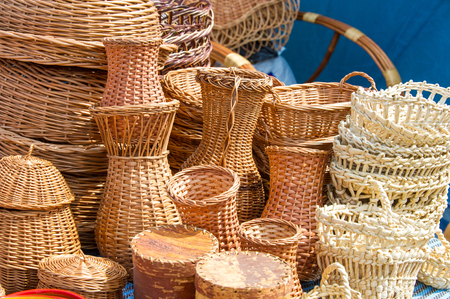 baskets woven from willow twigs. a container used to hold or carry things, typically made from interwoven strips of cane or wire.