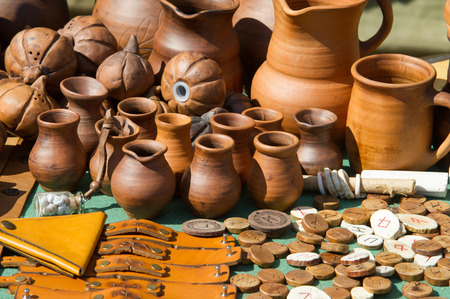 texture, background. clay pots. On the medallions painted runic symbols Stock Photo