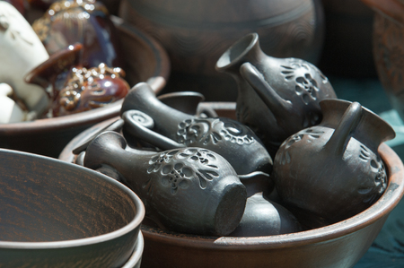 Texture, background. Pottery. pots, dishes, and other articles made of earthenware or baked clay. Pottery can be broadly divided into earthenware, porcelain, and stoneware. Stock Photo