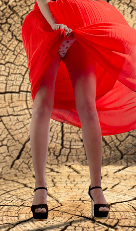 Legs, red pants, black high-heeled shoes, red dress, the wind picked up the dress visible panties, ??? Stock Photo