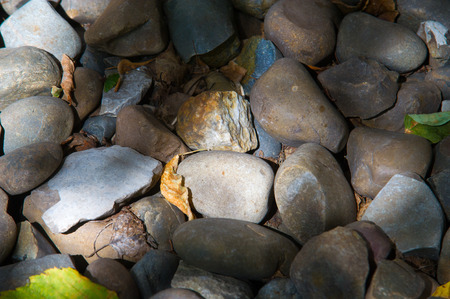 distinctive: Texture, background. pebbles. a small stone made smooth and round by the action of water or sand. Stock Photo