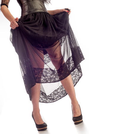 Young woman in black dress on white background. Girl in black dress, lace skirt.