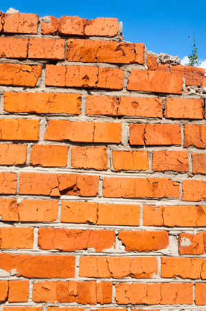 Texture of wall of bricks. Old abandoned wall, built of bricks Stock Photo