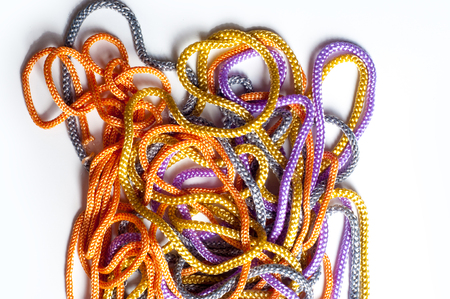 colourful tie: laces texture. wo lined boot laces on white background.  laces of different color isolated on white. Shoelaces. Multicolored shoelaces background
