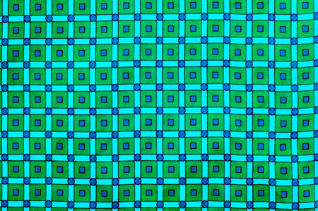 Texture, background. Fabric silk green checkered. Geometric figures