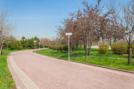 in the suburbs: Kazakhstan, early spring. Park of the first president of the country. Central park at sunny day. beautiful green park Stock Photo