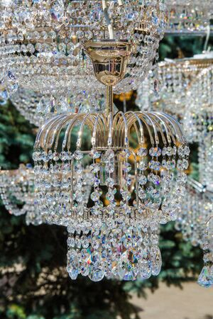 crystal chandeliers. a piece of a homogeneous solid substance having a natural geometrically regular form with symmetrically arranged plane faces.