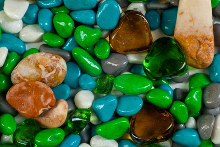 texture, background. Marine pebbles. Background of pebbles, various shells and glass hearts. stones background.