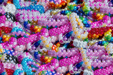 Seamless texture, background. Womens beads. Wear around the neck decoration in the form of beads strung on a thread or another form of small items.