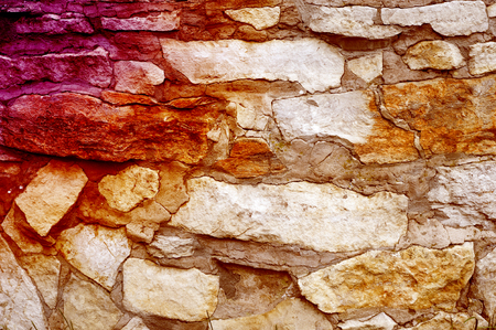 Texture, background, pattern. Natural stone lined wall. Hard rock chunks or solid mass, as well as a piece, vertical part of the building premises.