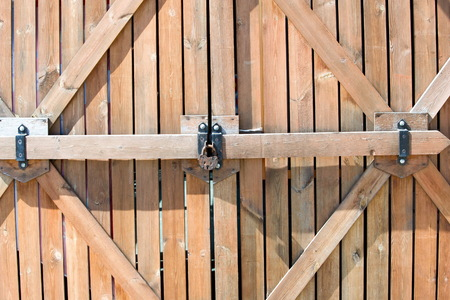 Wooden fence. a barrier, railing, or other upright structure, typically of wood or wire, enclosing an area of ground to mark a boundary, control access, or prevent escape. Stock Photo