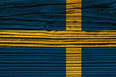 The texture of old wood (board). flag of Sweden  old wood background. old, grunge wood panels used as background