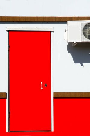 texture, background, pattern. red door. Aperture, a hole in the wall to enter and exit, as well as the target for closing this opening Stock Photo