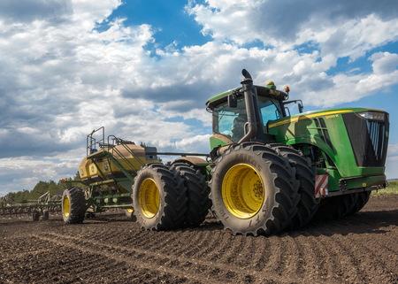 Naberezhnye Chelny, Tatarstan, Russia, 07. 04. 2015,  Tractor John Deere produces grain crops Editorial