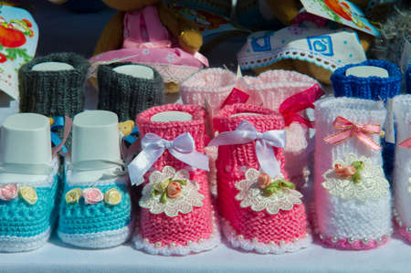 Texture, background, pattern. Baby booties, shoes for babies. Shoes with soft soles for toddlers