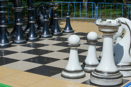 battle plan: Texture, background. Background. BIG chess in the park. Large chess game on ground in the park Stock Photo