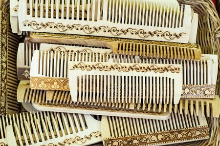 wooden combs. Comb hair combing. a strip of plastic, metal or wood with a number of narrow teeth, used for unraveling or arranging hair.