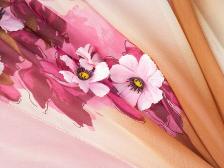 hilo rojo: Pink fabric inlaid flowers. texture. Photographed in the studio