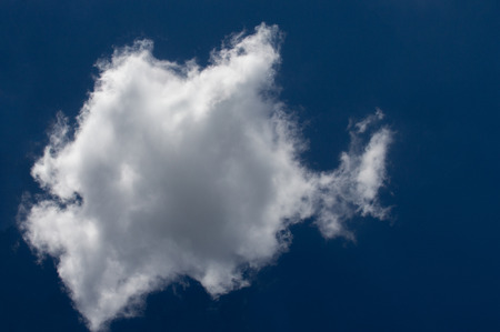 cumulus cloud, a cloud forming rounded masses heaped on each other above a flat base at fairly low altitude.