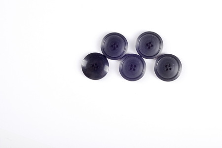 metallic button: sewing buttons collection. Various sewing buttons with a thread. isolated.  collection of various sewing button on white background.
