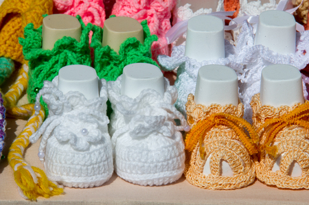warm cloth: Texture, background, pattern. Baby booties, shoes for babies. Shoes with soft soles for toddlers