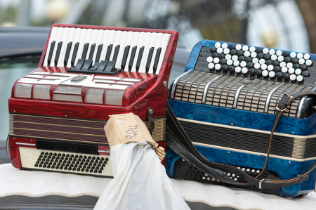 vintage accordion. a portable musical instrument with metal reeds blown by bellows, played by means of keys and buttons.